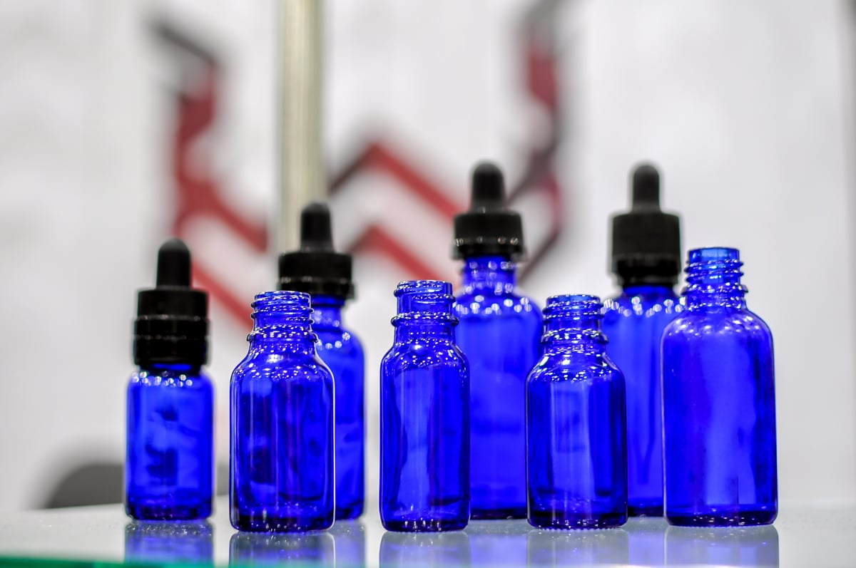 Blue Cobalt Bottles Coating and Glass Bottle Customization Packaging by FH Packaging at www.fhpkg.com Manufacturing at Wolfgang Enterprises